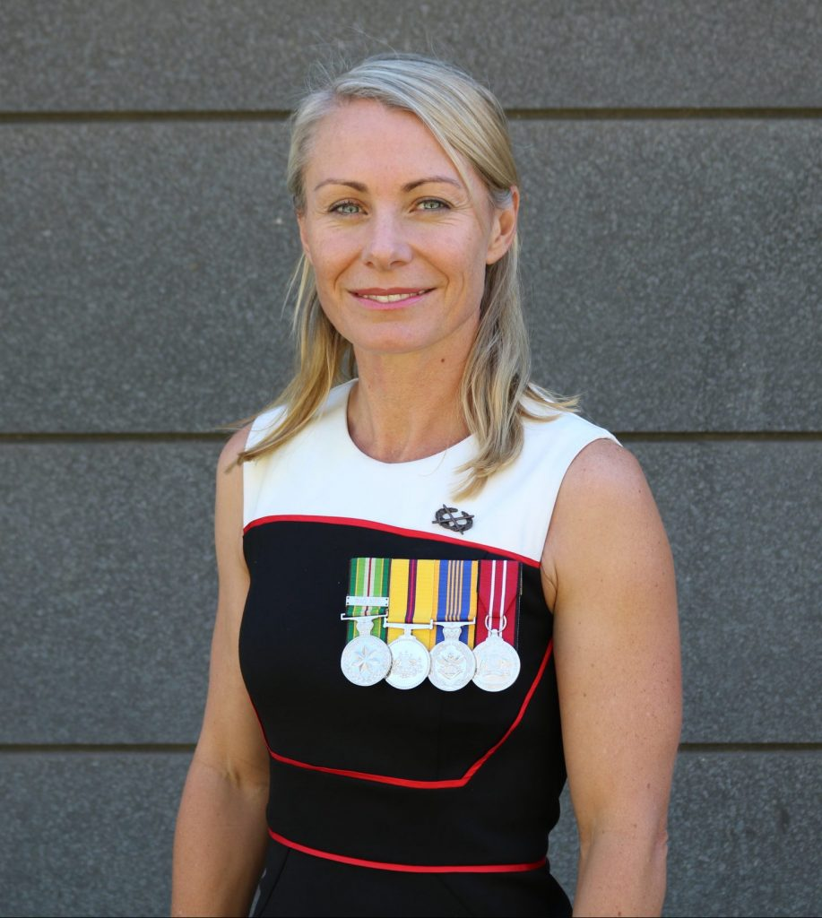 Portrait of Sarah Watson with Medals in Civilian Clothes